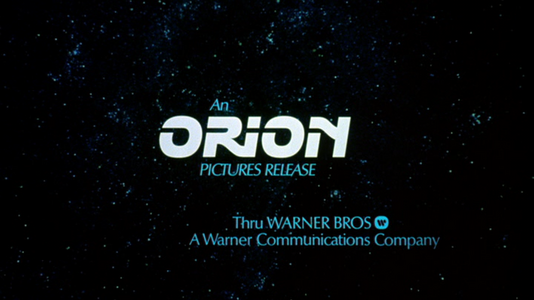 Orion Pictures (plasters 1980, off-center Warner byline).png