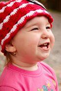 Smiling-baby-girl-11291665264HgI.jpg
