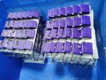 alt:Image showing a blue bin filled with palettes of Atomic Purple FunKey S devices.