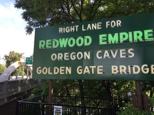 Signs at Caveman Bridge in Grants Pass pointing to Redwood Empire & Golden Gate Bridge