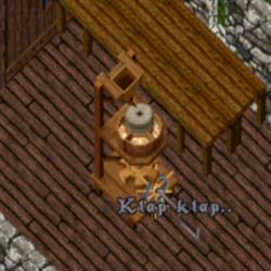 obrázek mlýna na mouku ze hry při mletí mouky znázorněného slovy klap klap napsanými nad pákou