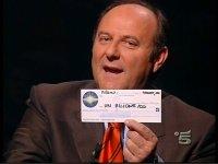 Gerry Scotti milionario assegno.jpg