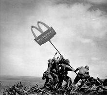 Soldati piantano lo stemma del McDonald's.jpg