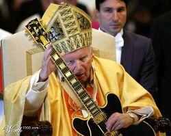 «Dogma N°8: Infallibilità papale L'assolo di Hotel California lo fa perfetto, è la chitarra che si mangia qualche nota.»