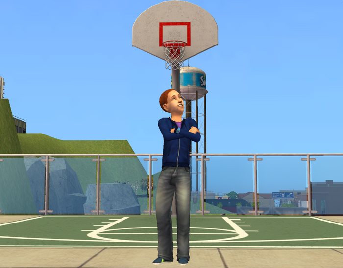 Justin Newbie in front of bball net.png