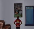 Bradley admiring soccer poster.png