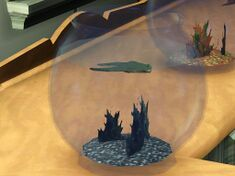 A frog swimming in an aquarium from The Sims 3: World Adventures.