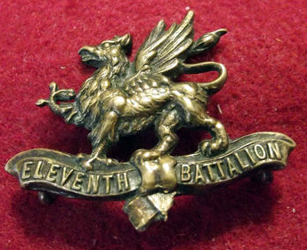 Damaged brass 11th Border Regiment cap badge.jpg