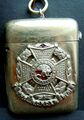 Border Regiment Collar Badge applied to Vesta Case.jpg
