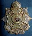 Brass Economy 1916 Border Regiment Cap Badge .jpg