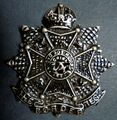 Blackened Border Regiment Cap Badge.jpg