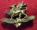 Damaged brass 11th Border Regiment cap badge.jpg