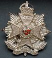 WW2 silver plated cap badge (front).jpg