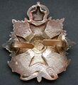 WW2 silver plated cap badge (rear).jpg